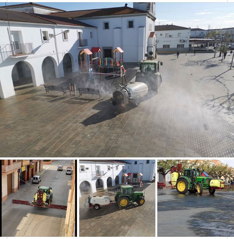Agricultores en tareas de desinfeccion en las calles de Guadiana, Badajoz, y Alparràs, Lérida. /joseantonioarcos.es